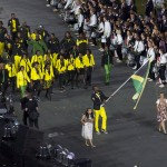 Usain Bolt bearing the Jamaican flag at the London 2012 Olympics